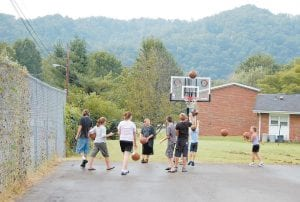 Children played on a new goal and with new basketballs given to them by members of the Rotary Club.