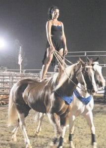 Dusti Crain wowed the crowd with her Roman-style horse riding show at the Isom Days rodeo on Saturday.