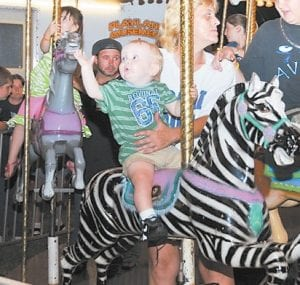"Spencer Warlick found a ride on the carousel to his liking on Friday night, easily taming this ""bucking zebra."""