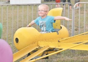 Jacob Fields was all smiles Saturday afternoon as he was gliding through the air on one of the rides at Isom Days.