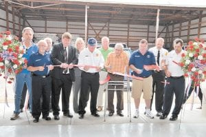 Officials including Letcher County Judge/Executive Jim Ward, State Rep. Leslie Combs and State Sen. Johnny Ray Turner joined Neon Fire Department personnel Carter and Marshall Bevins, former Letcher County Sheriff Maynard Hogg and others in cutting the ribbon to the department's new home in Fleming-Neon. (Photo by Chris Anderson)