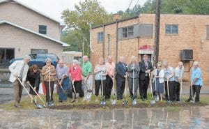 Pictured from left at Sunday's ceremony are architect Bill Richardson, Neon Librarian Jenay Hall, Library Board Member Margaret Lewis, Fleming- Neon City Council Member James D. Collins, Library Board President Jeanette Ladd, State Sen. Johnny Ray Turner, Jennifer Hall, Dr. Sam Quillen, Pat Wooten, a field representative for Congressman Hal Rogers; State Rep. Leslie Combs, Letcher County Judge/Executive Jim Ward, Library Board Member Mahala Frazier, Fleming-Neon Mayor Susie Polis, Magistrate Codell Gibson and Fleming-Neon Council Member Robert Champion.