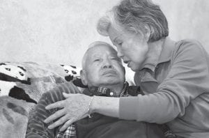 Shou-Mei Li, right, cares for her husband Hsien-Wen Li, who is an Alzheimer's patient, at their home in San Francisco. Dementia is poised to become a defining disease of a rapidly aging population — and a budget-busting one for Medicare, Medicaid and families. (AP Photo)