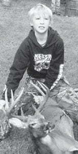 Henry Shannon Cowden, 11, killed this 11-point buck, his first deer, on Sept. 10. He is the son of Tony Cowden and Bridgett Cowden, both of Hampton Branch.