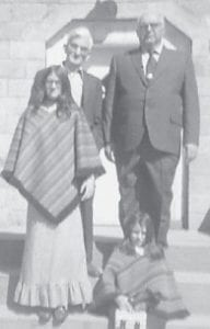 Robert 'Buddy' Wilson, Bill Howard, Kathy Niece Adams and Tammy Niece Allen stand on the steps of Whitco Pentecostal Church. Both girls now have adult children and grandchildren.