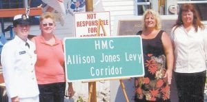 — Chief Hospital Corpsman Allison Jones Levy is pictured with her sisters, (left to right) Amanda Hammonds, Suzy Adams and Iva McIntosh, at a ceremony dedicating a section of US 119 in her honor.