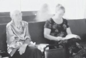 — Sandra Bailey, a church member for 32 years, took this photograph at the first meeting held in the new home of the Pentecostal Church on Craft's Colly. When the picture was developed, an image of what Bailey considers to be an angel was discovered behind her sister, Brenda, who says it is her guardian angel.