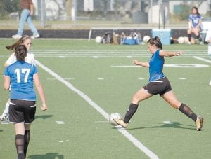— Letcher County Central forward Arianna Collins lined up a kick as the Lady Cougars toppled Lexington's Bryan Station 5-1 in a soccer match in Lexington on Saturday. Also pictured is Destiny Sturgill (17). The Cougars were 9-1 entering last night's match against Hazard. They will play at Clinton County on September 24. The LCC defense has shut out opponents in five of the nine wins, while giving up only eight goals in its first 10 games.