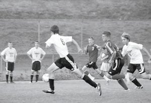 The Letcher County Central High School boys' soccer team entered play against Hazard Tuesday night with a record of seven wins, five losses and one tie. Above, Zach Joseph (6) and Isaac Gover cut off a South Laurel forward who was trying to score in the Cougars' 4-2 win recently. The team is coached by Joe Roberts.