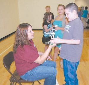 A nurse checked Steven Davis's grip strength at an Appalachian Regional Healthcare (ARH) fitness fair at Martha Jane Potter Elementary School last week. The students will do the fitness activities again next year to compare differences in a year. The fitness fairs encourage living an active life and maintaining a healthy diet. (Photo by Sally Barto)