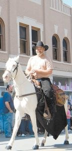 Jimmy McIntosh, of Craft's Colly, rode his horse, Silver, in the Mountain Heritage Festival Parade on Saturday.