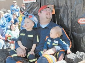 — Tyler Gilley and and his sister Gracie rode on a coal mining-themed parade float with their father, Matt Gilley, during Saturday's Mountain Heritage parade. (Photo by Chris Anderson)