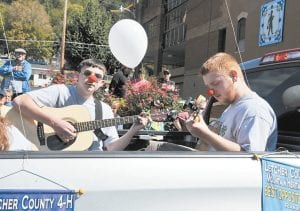 CLOWNING AROUND — Letcher County 4-H members Levi Caudill, left, and Logan Dollarhide were picking and grinning while promoting their club.