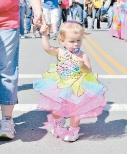 ALL DOLLED UP — Madison Duty was comforted by her pacifier as she strolled down Main Street.