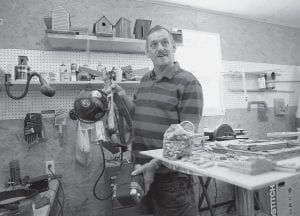 Former coal company owner and mine engineer Jerry Howard holds tools of his former trade as he stands in his woodshop in Garrett in Floyd County. Coal is deeply linked to the culture and economy in central Appalachia but the industry is facing an expected collapse in production over the next few years. (AP Photo/Ed Reinke)