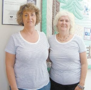 Lavonne Miller, left, and Shirley Nichols posed for this photograph in Whitesburg recently. The sisters met on the social media website Facebook and have been looking for information about their mom.