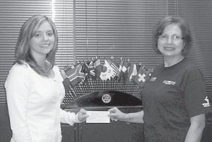 — Heather Dawn Blair (left) is the recipient of the fall Meryl Brown Rotary Scholarship. She is the daughter of Ronny and Gloria Turner of Haysi, Va., and lives in Letcher County with her husband, Mark. She completed an associate degree in radiological science in 1995 from Southeast Virginia Community College and a bachelor of science degree in nursing in 2011 from the University of Virginia's College at Wise, and is pursuing a master's degree in the health field concentration of family nurse practitioner at Old Dominion University in Norfolk, Va. She has worked in the health care field for the past 16 years and is working as a registered nurse while continuing her education. The scholarship is a $500 award given each semester to a Letcher County resident, based on achievement, character and need. Presenting the award was Whitesburg Rotary Club President Margaret Hammonds.