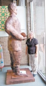 Maxine Bates Quillen stood beside a papier-mâché statue of Captain Martin Van Buren Bates. An art class at Letcher County Central High School made the structure, which is located at the Harry M. Caudill Memorial Library.