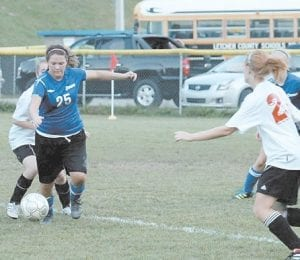 — Senior defender Brandy Porter (25) helped Letcher Central's girls' soccer team defeat Perry Central last week in Hazard. The Lady Cougars were 14-1-1 going into Tuesday night's matchup with Belfry at Belfry, and will visit Shelby Valley Thursday. Their last regular home game is Saturday at 6 p.m. against Whitley County. Letcher Central will host the district tournament beginning October 10.