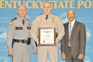 — Kentucky Vehicle Enforcement Sgt. Justin A. Pickrell (center) of Whitesburg received his promotion certificate from Ky. Justice and Public Safety Cabinet Secretary J. Michael Brown (right) and Kentucky State Police Commissioner Rodney Brewer (left) recently. A 9-year veteran, Pickrell will transfer from CVE Region 6 in Pikeville to Region 3 in Georgetown.