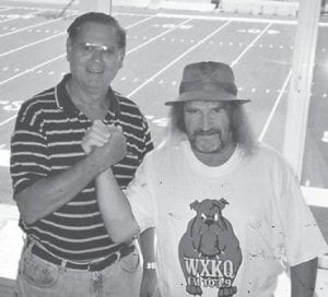 Pictured are Larry Hatton (right) and his friend Frank Perry, who retired after 26 years as scorekeeper and timekeeper of all Whitesburg High School sports and those at Letcher County Central. He will be sorely missed, says Whitesburg correspondent Oma Hatton.