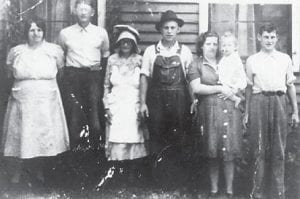 This photograph taken in 1942 shows Maggie and Leonard Fields, Nancy Halcomb (Mrs. Fields's mother), Willie St. John and wife Mae and son Ray and Jessie St. John. Mr. and Mrs. Fields were the grandparents of Oma Hatton and Nancy Halcomb was her great-grandmother.