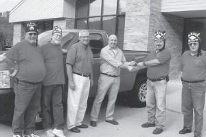 Dr. Kevin Roark won a 2011 Chevrolet Silverado at the annual Mountain Shrine Club fundraiser in Whitesburg on Sept. 24. Pictured from left are Paul Fields, Mick Polly, Cardinal Chevrolet General Manager Larry Turner, Dr. Kevin Roark, Whitesburg Mountain Shrine Club President James Absher and Bill Frazier. All proceeds from the fundraiser benefit the Shriner's Hospital for Children in Lexington.
