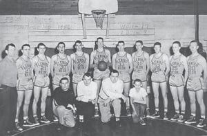 1956 Fleming Neon Basketball Team. Left to right are Coach Armstrong, Tyrone Bentley, Lawrence Kuhl, J.W. Vanover, J.P. Graham, Acie Hall, Harry Johnson, Charlie Creech, R. Whitaker, Bert Potter, and Leon Sergent. Kneeling are B. Cook, manage;, John Morgan, assistant coach; David Hurst, assistant coach; and M. Potter, manager. This team won 17 games and lost eight and finished the season as runner-up of the 53rd District. They lost out to county rival, Whitesburg High School.