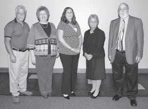"""FIVE HONORED — The Letcher County Chamber of Commerce recently honored four community residents for their continuing work as volunteers. The Chamber of Commerce also named a business owner as 2011 Businessman of the Year. Tim Breeding, pictured far left, received the business award. """"Unsung Hero"""" recipients include Rachel Breeding, April Damron Charles, Connie Hall Fields and Eugene Meade."""