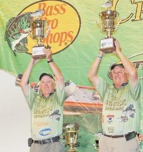 Bill Braswell, left, and Dan Dannenmueller hoist their trophies