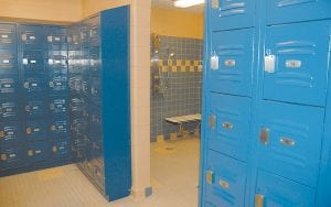 In photo at right, lockers and showers can be seen in the men's locker room.