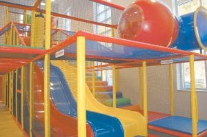 The indoor playground is 2-1/2 stories tall and contains a triple slide, an obstacle course, a separate area for toddlers and an enclosed spiral slide.