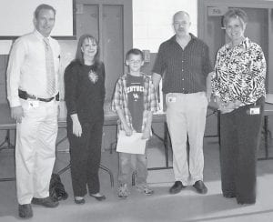 Israel Childers, an elementary school student at the Burdine Campus of the Jenkins Independent School System, is the winner of a computer. The school system is giving away a computer every six weeks to a student with perfect attendance for that grading period. Pictured are (left to right) Director of Pupil Personnel Harvey Tackett, Superintendent Debbie Watts, Israel Childers, District Technology Coordinator Damian Johnson, and Burdine Principal Gracie Maggard.