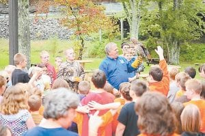 Students from West Whitesburg Elementary School recently looked at a redtailed hawk named Journey at Southeast Kentucky Community and Technical College in Whitesburg. Pictured holding Journey is Mitch Whitaker, a master falconer who works at the Letcher County Extension Office. (Photo by Mitch Caudill)
