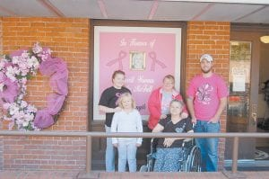 Whitesburg City Council Member Freda McFall (pictured front and center) is pictured with her granddaughters Alexis Johnson and Paige Caudill, her grandson Josh McFall and her daughter Stephanie Johnson. Josh McFall decorated the front of Whitesburg City Hall in observance of National Breast Cancer Awareness Month and in honor of his grandmother, who is battling breast cancer.