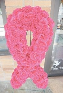 A pink ribbon made of flowers was on display in front of Whitesburg Florist.