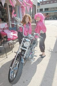 """Narramore Dentistry employees Natisha Lewis and Holly Back dressed as """"pink ladies"""" Oct. 14 in honor of National Breast Cancer Awareness Month."""