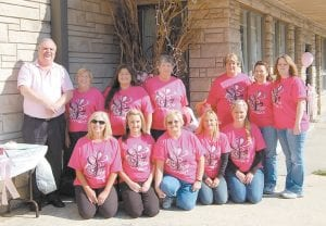 Employees of Dr. Collins Rural Health also joined in the fun. They are (front row, left to right) Cathy Campbell, Crystal Sparkman, Tilitha Sperger, Wanda Moore, Katina Benton, (back row) Dr. Bill Collins, Sue Holbrook, Kristi Roark, Carol Whitt, Tracy Day, Bernadine Miracle and Melissa Halcomb.