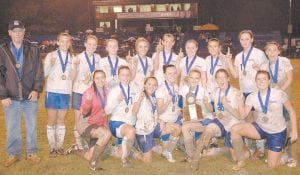 The Letcher County Central High School girls' soccer team defeated Perry Central 4-1 on October 13 to claim the District 32 championship. Pictured are (standing, left to right) Coach Greg Collins, Kelsie Cornett, Courtney Venters, Meg Raleigh, Auberney Campbell, Brooke Adams, Carlie Combs, Courtney Wilson, Destiny Sturgill, and Brooke Kincer. Kneeling front row (from left) are seniors Jasmine Glispie, Erica Adams, Kyli Breeding, Erica Meade, Lindsey Kincer, Brandy Porter, and Arianna Kincer.