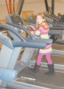 Megan Mc- Cown, of Eolia tried out one of the new treadmills at the Letcher County Recreation Center. She is the daughter of Amanda and Brian McCown.