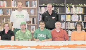 Ethan Bowling, a senior at Jenkins High School, has signed to run for the University of Pikeville next year. Pictured are (front row, left to right) Lynn Gilliam, Robert Adams, Ethan Bowling, Quinn Bowling, Jeannie Ann Bowling, (back row) Jenkins Athletic Director Larry Maggard and University of Pikeville Coach John Biery.