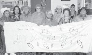 THE OVENFORK CENTER celebrated 'Stamp Out Elder Abuse' Month on Oct. 18. Pictured (left to right) are Faye Halberstadt, Fran Ryan, Jewell Maggard, Ruby Adams, Bennie Sturgill, Elaine McFarland, Peggy Sturgill, Marvline Quillen, Carmen Brock and Linda Curry.
