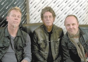 """Metallica members James Hetfield, left, and Lars Ulrich, right, pose with musician Lou Reed in New York. Metallica and Reed teamed up for Reed's latest release, """"Lulu."""" (AP Photo/John Carucci)"""