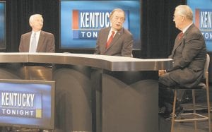 TEMPORARY PLEASANTRIES — Independent candidate Gatewood Galbraith, center, made a point while Democratic Gov. Steve Beshear, left, and Kentucky Senate President David Williams, Republican, listened before their gubernatorial debate at the Kentucky Educational Television studios in Lexington on Monday. (AP Photo/ James Crisp)