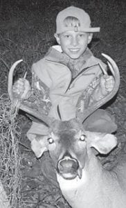 Matthew Dicks, 10, is pictured with a sixpoint buck he killed on Oct. 6. He is a student at Cowan Elementary School and is the son of Steve and Valerie Dicks of Kingdom Come Creek. His grandparents are Alan and Linda Dicks of Kingdom Come Creek, Jerry and Peggy Sturgill of Kingscreek, and the late Ricky Adams of Sandlick. Matthew was accompanied hunting by his father, Steve, and his grandfather, Alan.