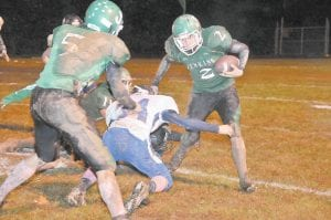 Jenkins senior Kevin Brown worked around the Betsy Layne defense while assisted by teammates Cody Sexton and Charlie Cox in the Cavaliers' 20-6 loss Friday night. The Cavs finished the season with a 1-9 record with the loss. They will travel to Williamsburg this week for the first round of postseason play. (Photo by Chris Anderson)