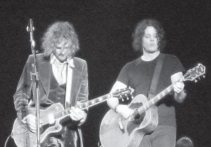 RACONTEURS AT WORK — Brendan Benson (left) and Jack White performed with their band The Raconteurs at the Voodoo Music Experience, attracting one of the largest crowds during the three-day event.