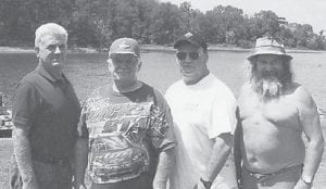 Four Hatton brothers, Rob, Astor, Billy and Larry, found time to go to a lake while they were attending the Bristol races.
