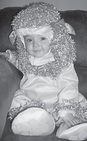 Halloween dressed as a pink poodle. She is the daughter of Sheblena and Derrick Adams. Her grandparents are Debra Seals, and Chris and Diane Sexton. Her great-grandparents are Dennis and Shelby Seals, and L.C. and Joyce Adams.
