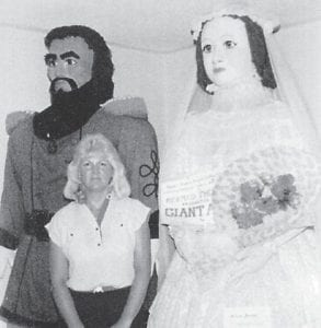 Portrayals of Captain Martin Van Buren Bates, a Letcher County native, and his bride, Anna H. Swan, were found in a museum in Tatamagouche, Nova Scotia, Canada in 1988. Pictured in front of the figures is Sue Dugan, daughter of Mildred A. Zimmerman of Independence.